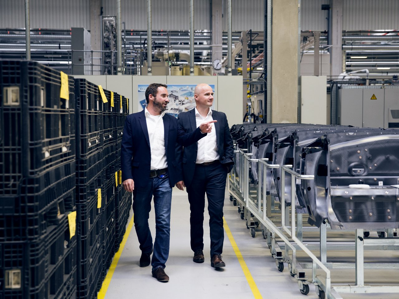 Herwig Fischer (l) and Robert Hütter (r) during a tour through the production facilities in Ort and Ried im Innkreis.